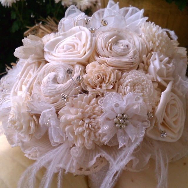 This fabulous Bouquet was made from vintage lace, balsa flowers, feathers and vintage jewelry. What made it special was a few craft sessions with the Bride and the MOB to help prep some of the lace to create the flowers. Just another way to have an elegant event without live flowers.