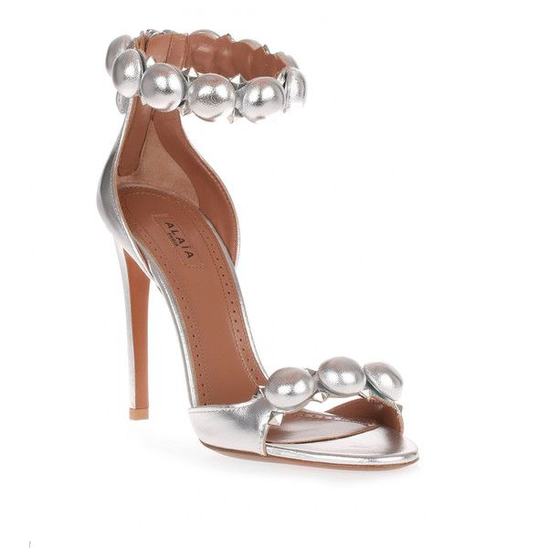 Alaïa Metallic Leather Bomb Sandal ($1,010) ❤ liked on Polyvore featuring shoes, sandals, silver, silver metallic sandals, high heels sandals, leather sandals, metallic shoes and ankle strap high heel sandals
