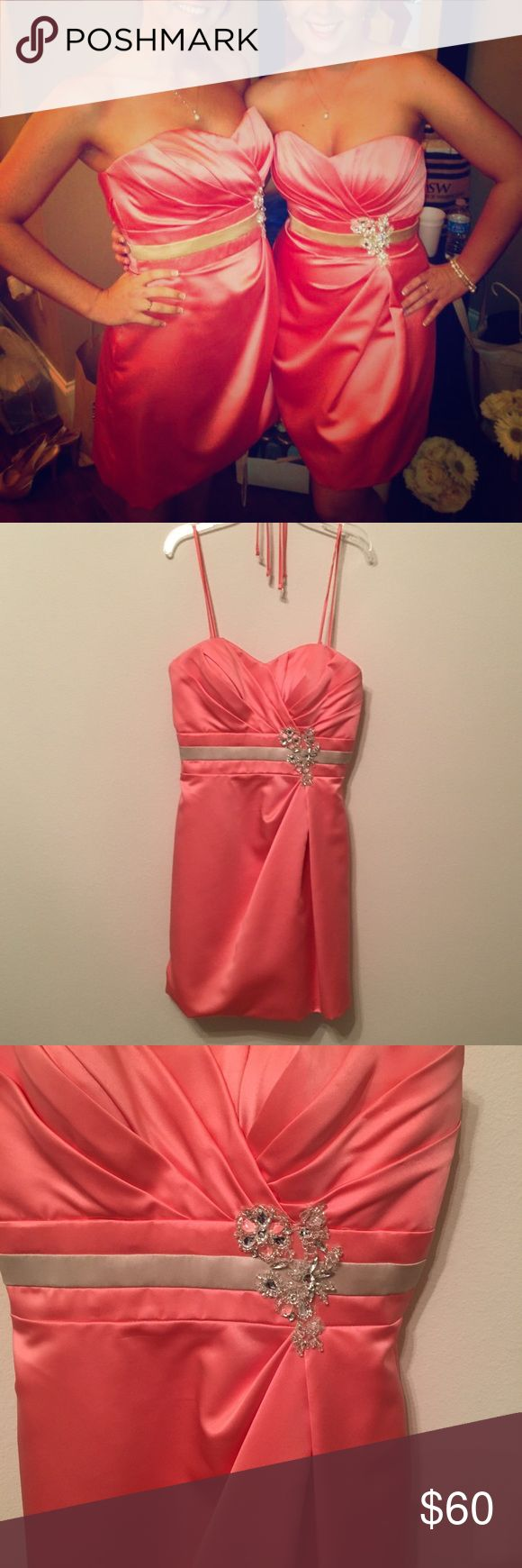 "Coral color bridesmaid dress worn once Strapless Coral colored bridesmaid dress with crystal beading embellishments  Worn once. Would make for cute prom dress.  Extra straps included.   Says size 6 but was altered to fit me.  I was about 5'2"" and 120lb at the time   Purchased from local/New Orleans bridal boutique. NOT a David's bridal Dresses Prom"