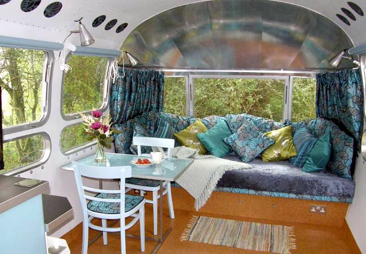 refurbished Airstream! Love the table and chairs but where to secure when driving? Also love comfy sofa and colors