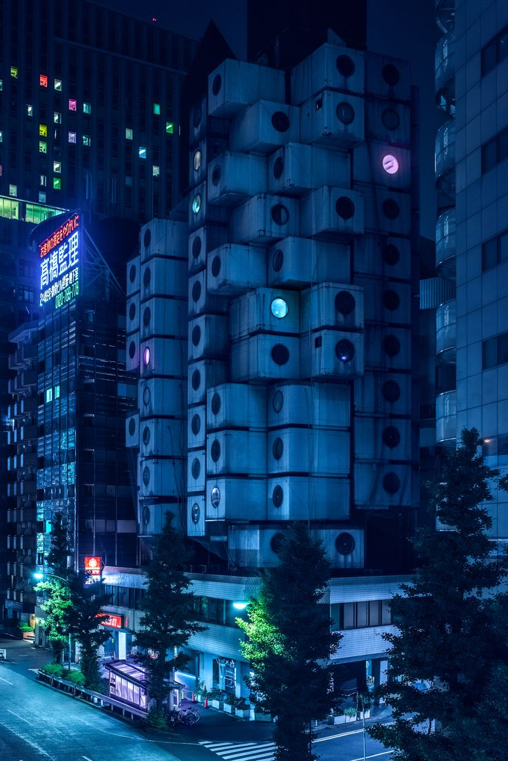 "Australian photographer Tom Blachford waited until night to capture these neon-tinted photographs of Tokyo's metabolist buildings, which he says could have been built in a ""distant future""."