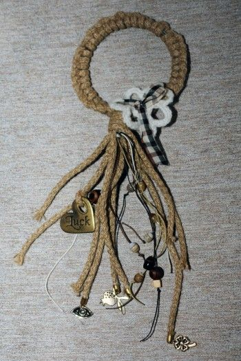 Circle charm made by wooden rope