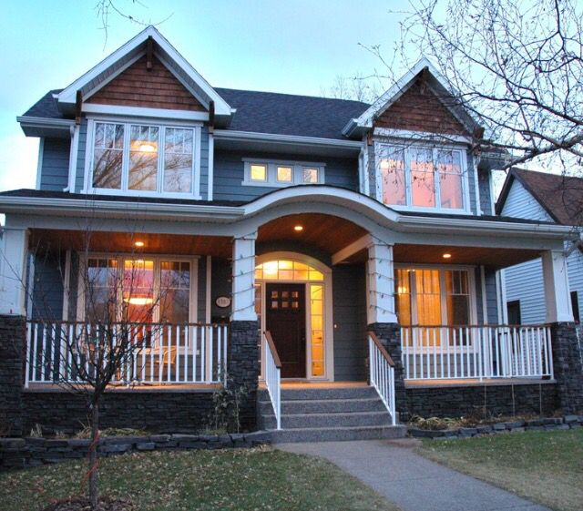 Love the blue house, white trim and the natural cedar shingles. Would look great with blends of brown, tan, grey stone and brown garage doors,