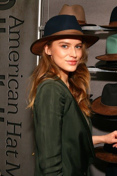 Tanya Mityushina, Sports Ilustrated Rookie, wearing a navy blue wool felt pinched crown Summit with a saddle leather brim.