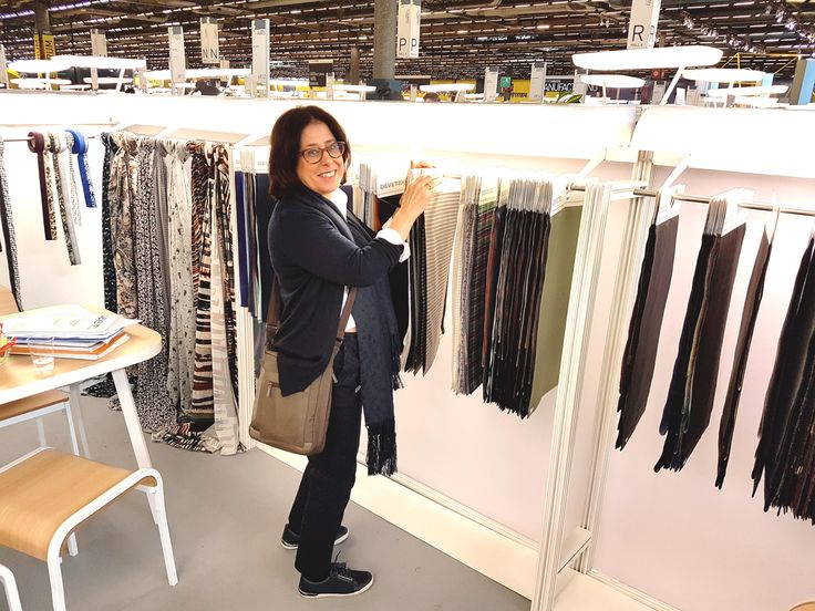 MD Debbie Leon looking at fabric swatches Premiere Vision 2016