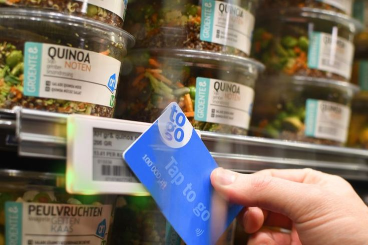 Dutch supermarket chain Albert Heijn's 'Tap to Go' technology. Tap to Go works alongside smart NFC-enabled shelf labels. After a consumer has registered via an app, they are then able to shop as usual, but tap a physical card to the shelf labels as they pick up the items they wish to purchase. In a matter of minutes, the money will be automatically transferred from their bank account, making it possible for shoppers to skip the long lines.