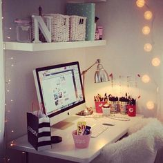Teen Desk Area - White storage baskets on shelves, iMac, cute things.