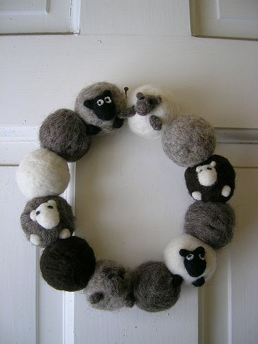 """Ravelry ~ jspotter's """"not so sleepy sheeps wreath"""".  From the book """"Fuzzy Felted Friends"""" by Saori Yanaaki (ISBN: 978-0-8118-6066-6).  It looked like the bodies were needle felted, but it turns out that they were made of pom poms."""