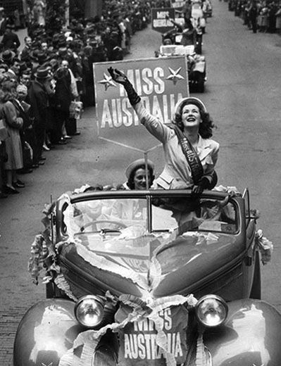Miss Australia 1947, Judy Gainford waving to the crowd in an open top car at a Miss Australia street parade