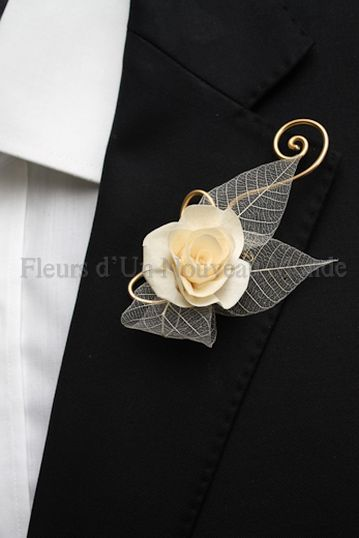 buttonhole with skeleton leaves/  deland fl wedding flowers 32724/ orange city fl wedding flowers/  volusia county wedding flowers/ www.callaraesfloralevents.com
