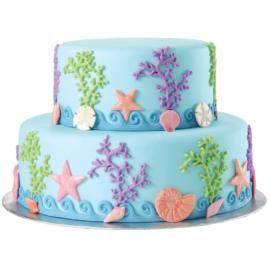 Sea Life All Around Cake. Magical marine characters charm this two-tier, fondant beauty. Our Fondant & Gum Paste Mold, Sea Life Designs, creates these lovely creatures, coral and waves.  #wiltoncontest