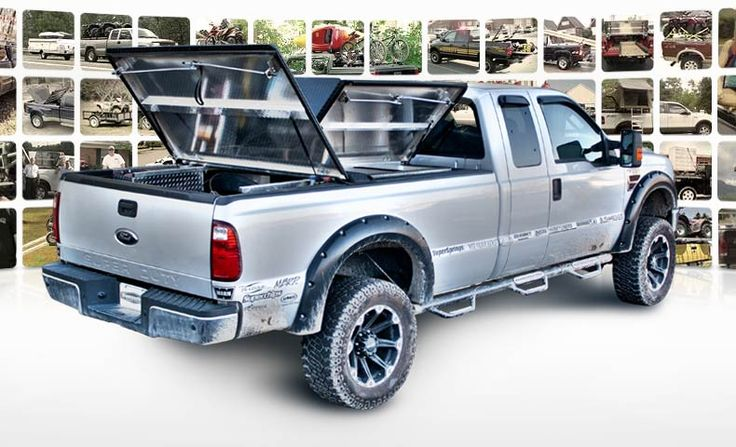 DiamondBack 270 truck bed cover with 3 panels open on silver Ford Super Duty