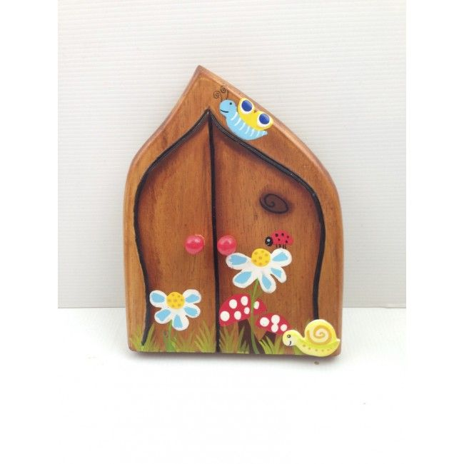 We're in love with this beautiful, wooden fairy door! It is handmade and painted by artisans in a small village in Bali, and made with sustainable wood. A truly whimsical gift, that children will adore in their rooms. #fairydoor #woodentoy #entropytoys #magical #fairies #elves
