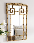 This unique mirror has a very interesting frame that adds decorative detail on the mirror. This is very artistic décor for your home with some of the framing material going over the mirrored area in a wonderful design.