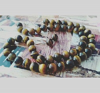 Tiger's eye semiprecious beads set jewelry with sterling silver accesories