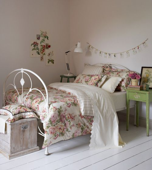Whitewashed floors and rose covered linens