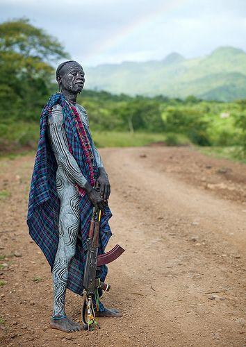 Eric Lafforgue  www.ericlafforgue.com Surma warrior with AK-47 near Turgit - Ethiopia