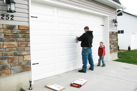 7 home remodeling projects with top dollar returns for Wood veneer garage doors