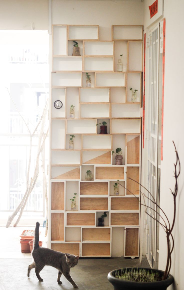 Large plywood shelves can be constructed of numerous single cell units for interesting effect. Although the spaces here are all fairly small and similarly non functional in my opinion.