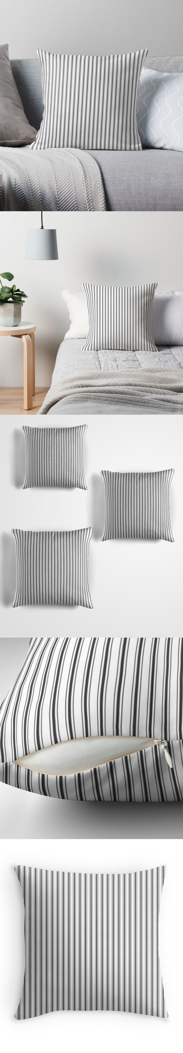 The stitched and woven straight vertical lines of one thin stripe either side of a wider stripe are found in the traditional mattress ticking pattern.The classic black and white ticking seen in mattresses, bedding and pillow covers is known the world over and is here in a narrow version.
