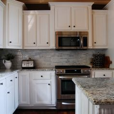 microwave above stove with raised cabinet above