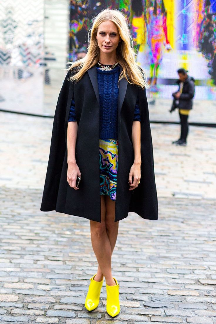 Poppy Delevingne injects her outfit with the cape factor. She wears it well.