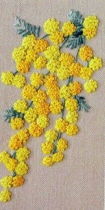 Beautiful embroidered yellow flowers, looks like they're made up of French Knots. Bordado