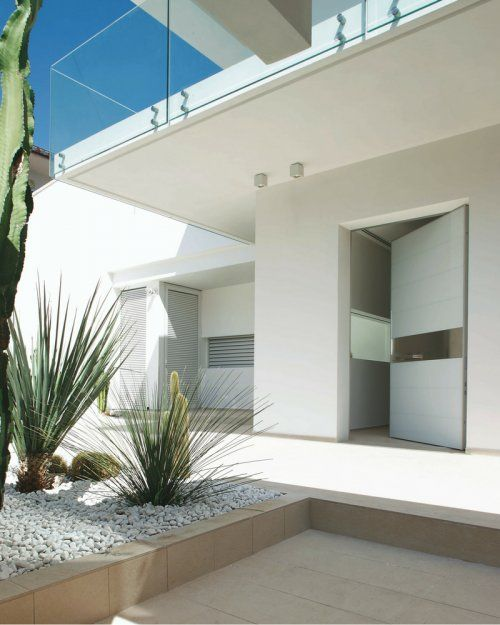 . The Apertio Solid front door on an ultra modern house design