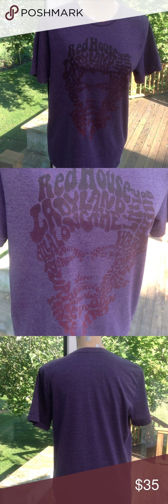 Jimi Hendrix Tee! This  purple cotton t shirt features his songs outlining his face: Purple  Haze, Voodoo, Red House, etc. Karl Ferris Shirts Tees - Short Sleeve