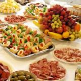 Cocktail hour - tea party snacks:  fruit and vegetable tray with dips, pickled relishes, sausage/meat tray and finger foods such as 'wrapped chestnuts'