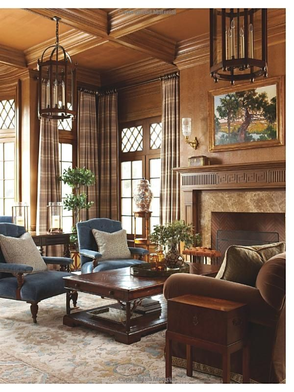 The rich paneling lends a masculine feel to this elegant living area.