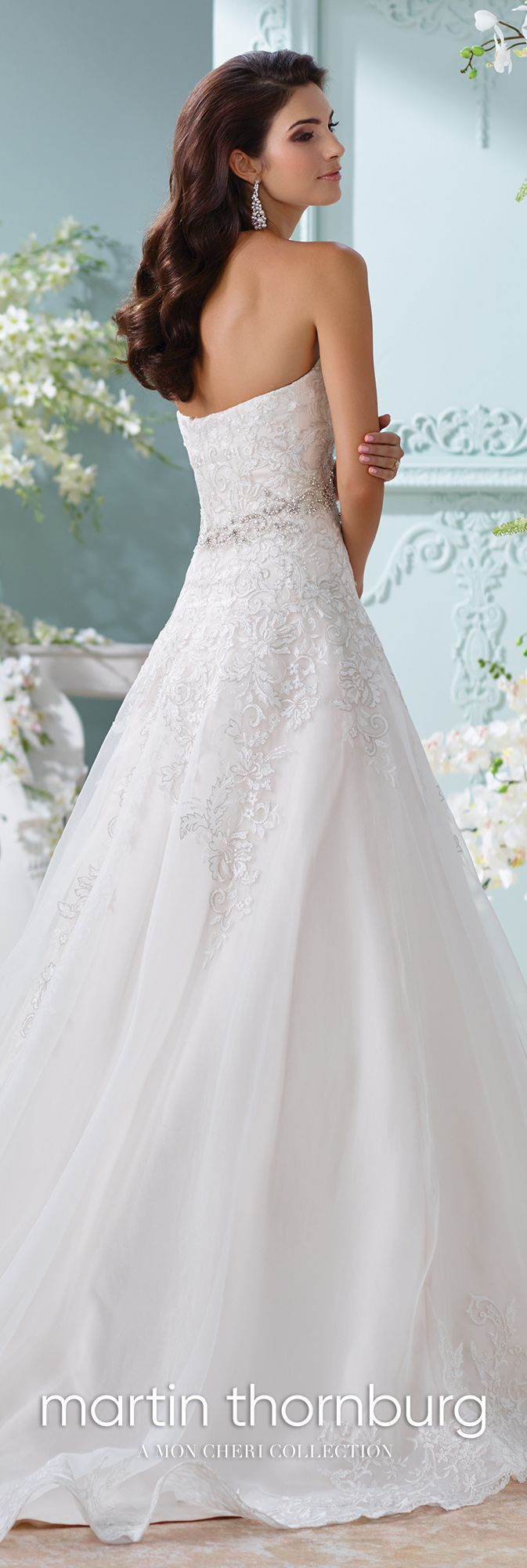 Martin Thornburg 116210 – Laina - Strapless organza and lace Aline wedding dress,metallic Schiffli lace appliqués over satin gown with sweetheart neckline, hand-beaded jeweled motif at natural waist, scalloped hem and chapel length train, detachable spaghetti and halter straps included.