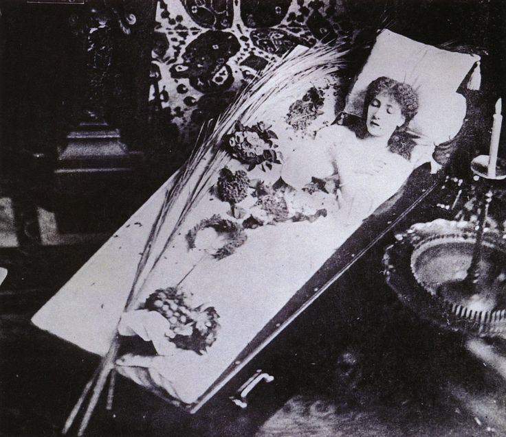 """The Great Sarah Bernhardt Asleep in Her Coffin, Silver gelatin print, circa 1882    Bernhardt (1844-1923) made her own funeral arrangements. She picked out her own coffin because she was going to """"sleep"""" in it forever. She had it delivered to her home and regularly slept in it. In her 1907 autobiography she wrote, """"My bedroom was very tiny. The big bamboo bed took up all the room. In front of the window was my coffin, where I frequently installed myself to learn my lines.""""Self Portraits, Post Mortem, Postmortem Photography, Circa 1882, Sarah Bernhardt, Bernhardt Asleep, Photos Session, Actresses, Coffin"""