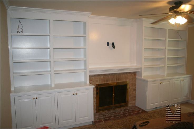 Built-in cabinetry with storage base cabinets surrounding ...