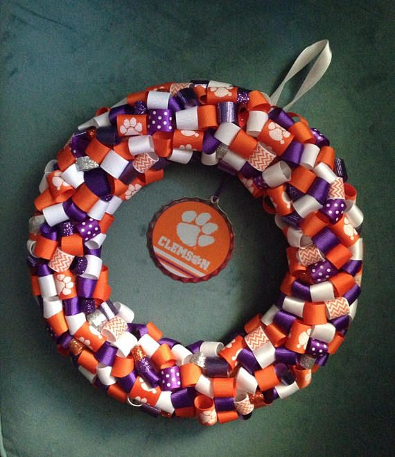 Handmade using ribbon and an ornament bought at the bookstore! This is a 10 diameter rolled ribbon wreath. It can be hung anywhere! It also comes with a protective hard case! The ornament in the middle is metal with Clemson and a tiger paw. Happy Trails