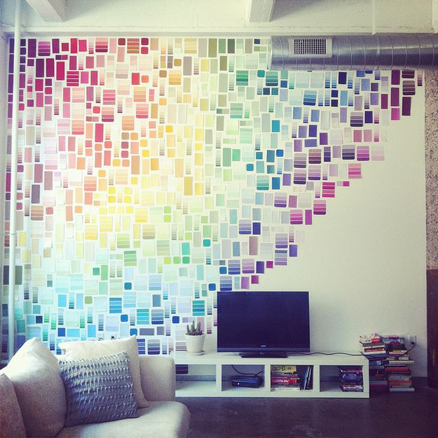Use paint chips to cover an entire wall. Use removable poster tape or painters' tape to minimize wall damage.