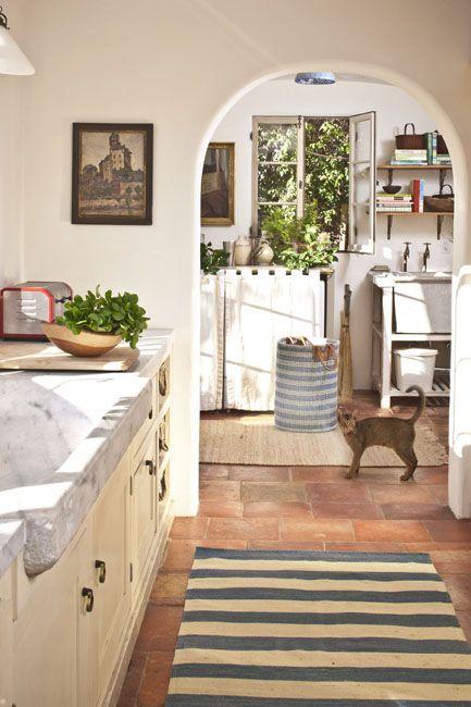 Love the spanish style - arched doorways, plaster/stucco walls, tile floors. Westside Provencal | Schuyler Samperton Interior Design