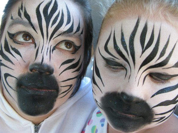 Zebra face paintings... this is a much more realistic design than most.