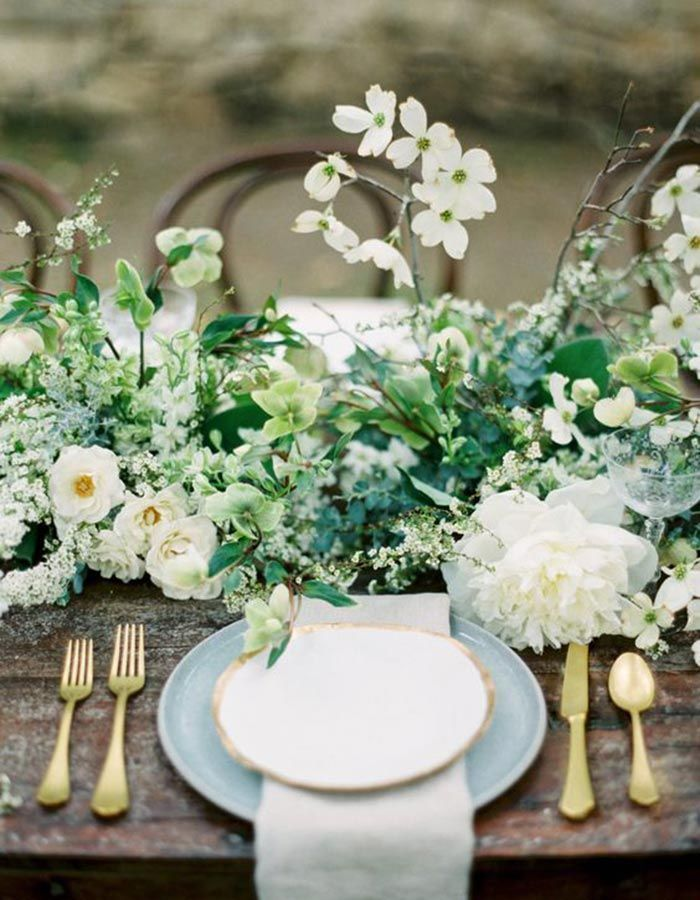 Add some nature to your centerpieces at your outdoor wedding with fresh greenery picked from the garden!