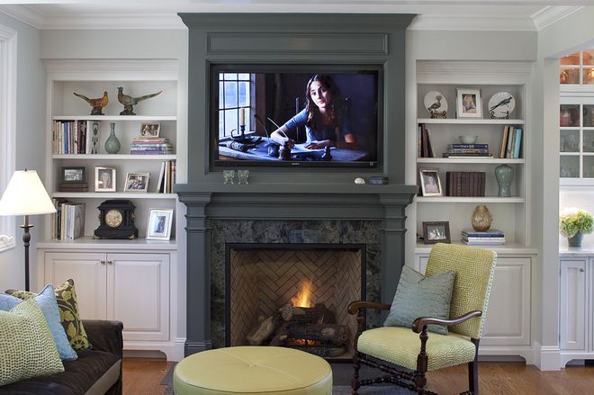Painting your surround, mantel and chimney breast a color that contrasts with the rest of the woodwork — particularly if the rest of the millwork is white — is a stellar way to bring interest and depth to your room.