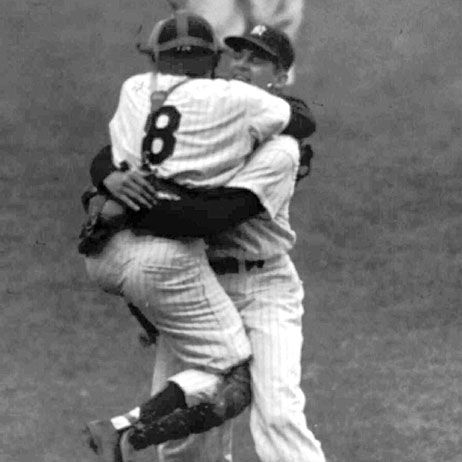 Yankees catcher Yogi Berra leaps into the arms of pitcher Don Larsen after Larsen struck out Dale Mitchell of the Brooklyn Dodgers to complete his perfect game in Game 5 of the World Series on Oct. 8, 1956. (AP Photo)