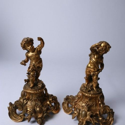 "CANDLEHOLDERS  Epoque : 1870 Dimensions : H. 40cm. L. 28cm.  ""Cupids"" Chiseled and gilt bronze sculptures, Napoléon III style."