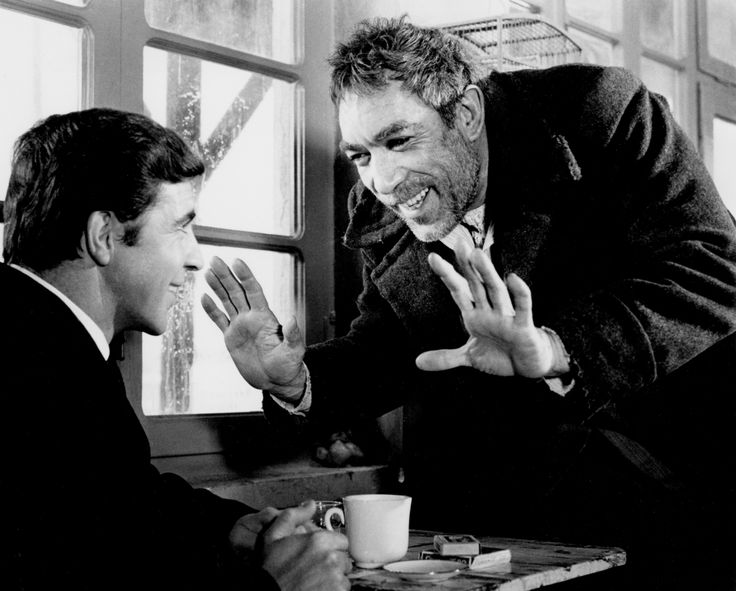 "Alan Bates and Anthony Quinn.  1964.  Zorba the Greek.   ""Boss.  Life is trouble!  Only death is not.  To be alive, is the pull up your pants and look for trouble!""  Great film!  Great novel!"