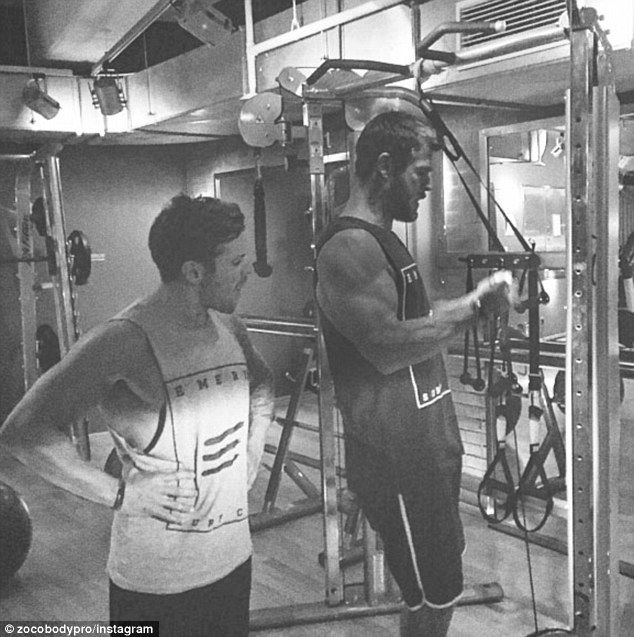 That arm again! Chris Hemsworth shows off that bulging bicep as he pumps steel in the gym ahead of The Huntsman: Winter's War promotional tour in Germany on Tuesday