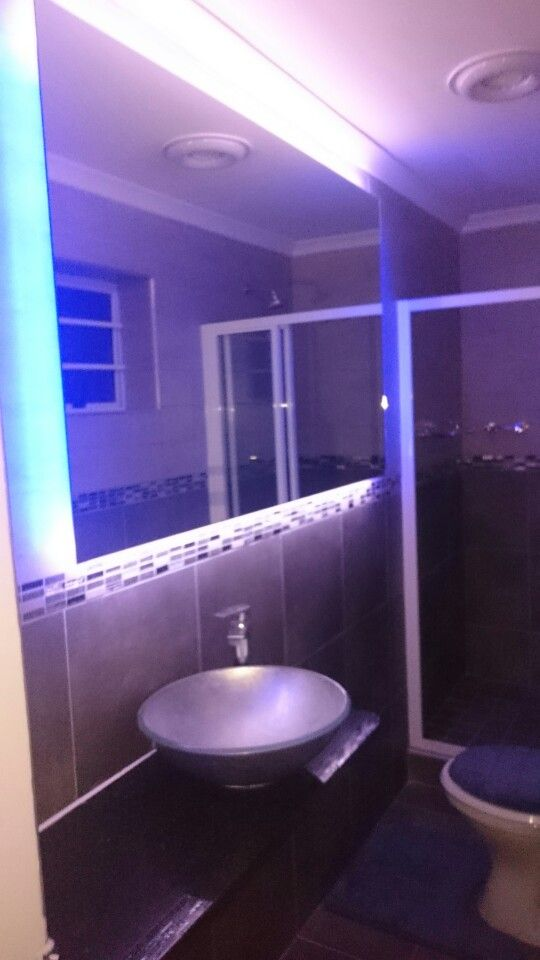 My en suite bathroom mirror and basin. Glass from PG Glass. LED strips and power supply  from EP Electro in Uitenhage. Granite top Evans & Sons. Basin Bathroom Bizarre. Cobra Karoo tap EPS Plumbing supplies. Tiles from Tile Africa.