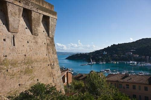 Picture of Porto San Stefano harbor and its fort.