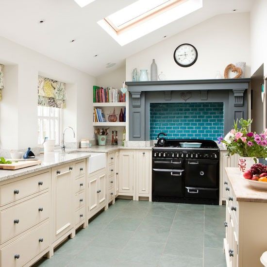 Nice to make a feature of the cooker alcove with contrasting tiles and wooden surround.