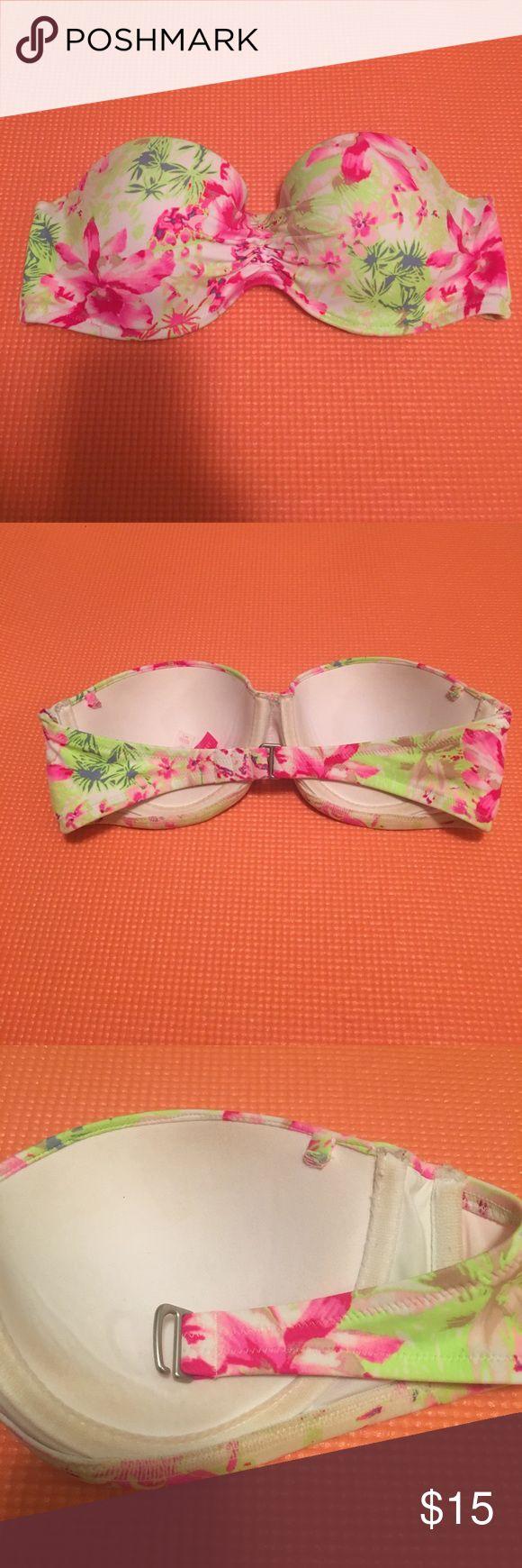 Victoria's Secret Bandeau Bikini Top Victoria's Secret Bandeau Bikini Top. Colorful floral print. Ruched center, silver clasp. Has halter strap, no removable padding. Size 34C. Victoria's Secret Swim Bikinis
