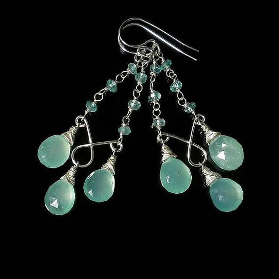 I wire wrapped aqua gemstone chalcedony briolettes and attached them to sterling silver chandeliers to make these fabulous earrings. They dangle from sterling ear wires with a handmade chain of apatite rondelles. Their aqua color is spectacular! They hang 2 5/8 inches (5.2cm) long. The wire