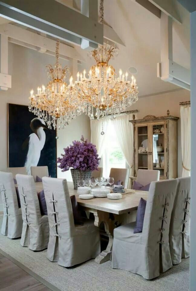 Dining room beamed ceiling and crystal chandeliers